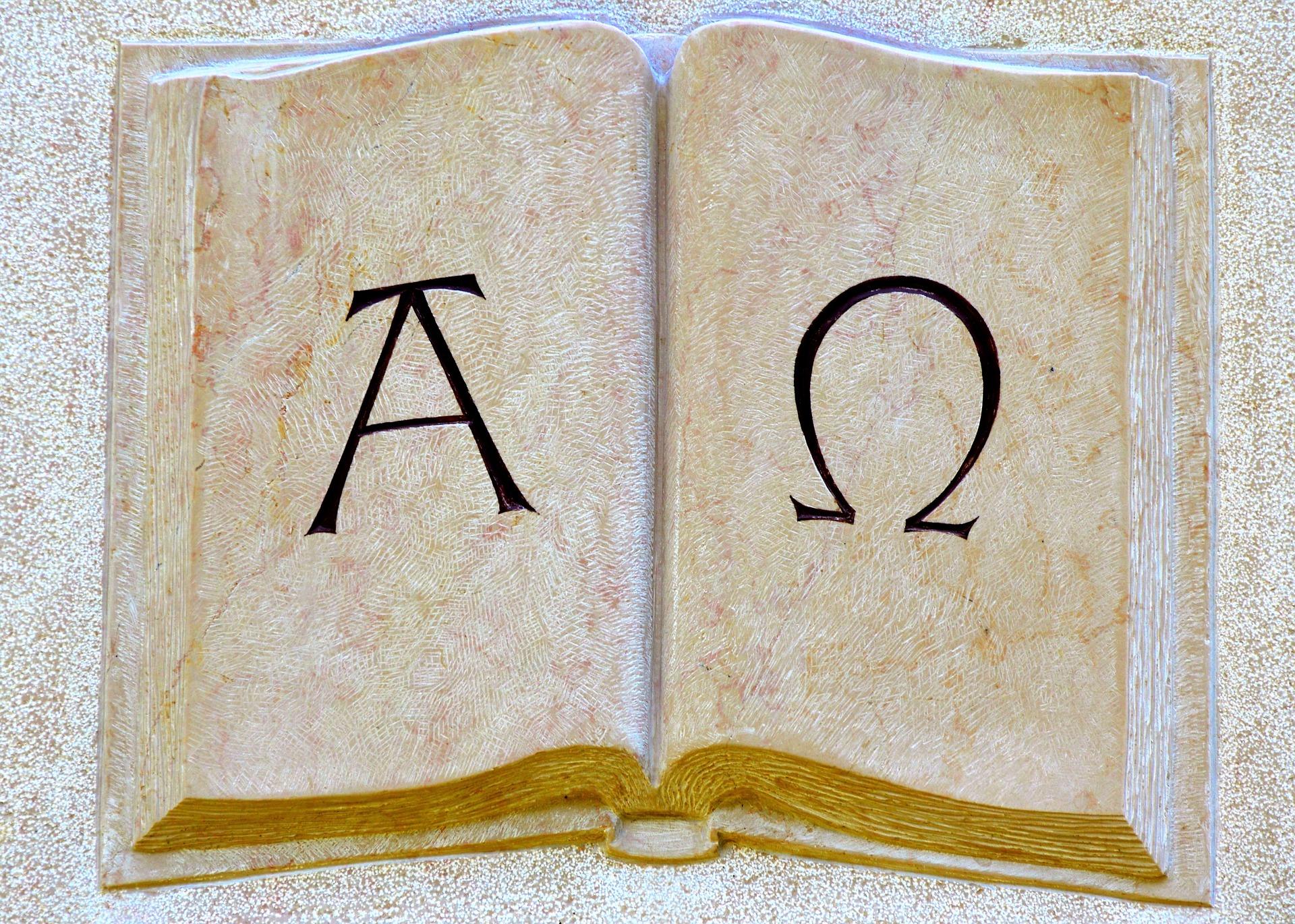 Aufgeschlagenes Buch mit Alpha und Omega